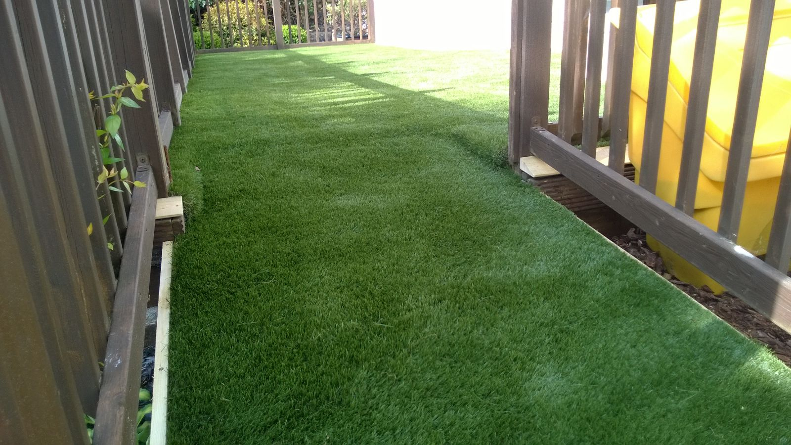 Artificial grass on decking by sussex artificial grass company for Garden decking and grass